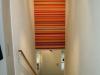 Treppenhaus multicolor gestaltet von Urs Heinrich